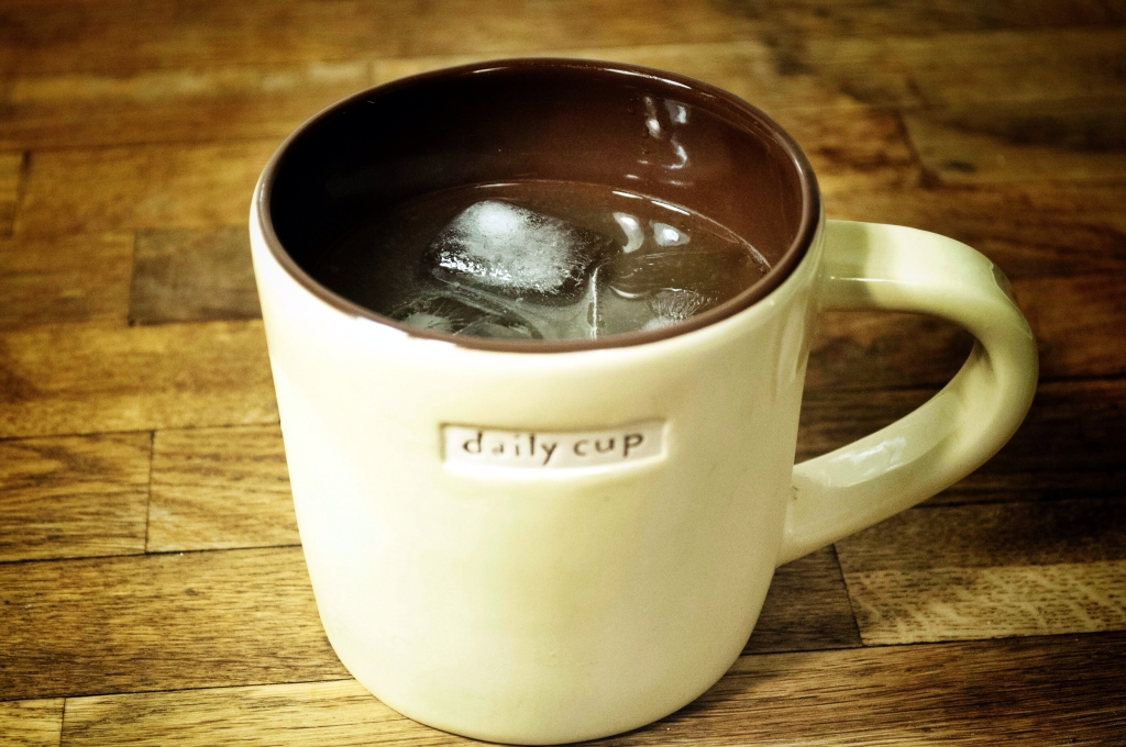 A whiskey sour in a mug