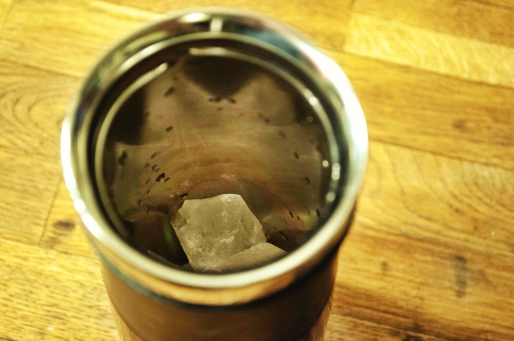 Step one: ice in mug